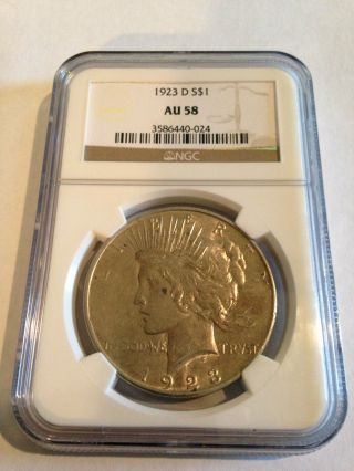 1923 - D Peace Dollar Graded Au 58 By Ngc - Coin photo