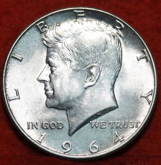 Uncirculated 1964 90% Silver Kennedy Half photo