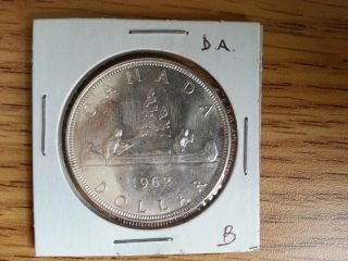 1962 Canada Silver Dollar - Double Arrow Head.  Grade.  See Pics.  B photo