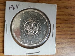 1964 Canada Silver Dollar - Grade.  See Pics. . photo