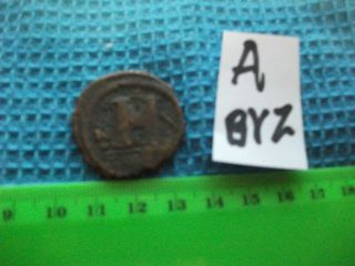 Large (30mm) Byzantine Coin,  Eastern Roman Empire,  Ancient. .  (a - Byz) photo