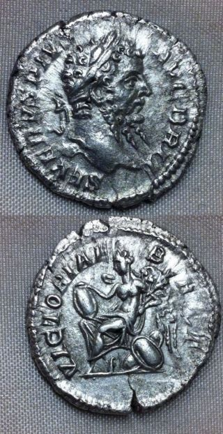 Roman.  Septimius Severus.  Silver Denarius - Victoriae Brit - Victory Seated photo