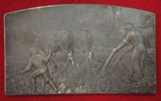 Silver Plaque Depicting An Agricultural Scene photo
