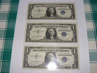 1957 - B Three Consecutive $1 / Uncirculated Silver Certificates photo