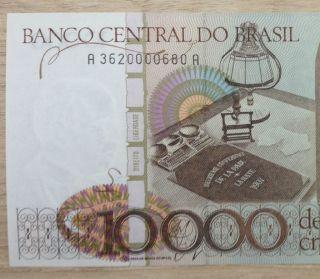 Brazil 10000 Cruzeiros 1985 P 203b Fist Serial 3620 Unc.  Very Scarce photo