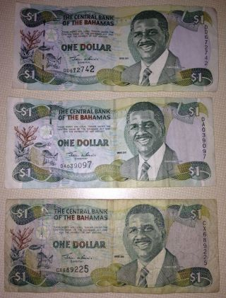 The Central Bank Of The Bahamas (3) 1 Dollar Notes - 2001 photo