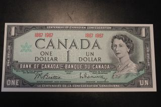 Canadian 1967 $1 Bill With Date.  The Bill Is,  Crisp & Uncirculated. photo