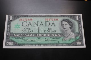 Canadian 1967 $1 Bill With Serial Number.  The Bill Is,  Crisp & Uncirculated photo