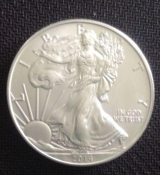 2014 1 Oz Silver American Eagle Bu $1 Coin.  999 Fine Silver photo