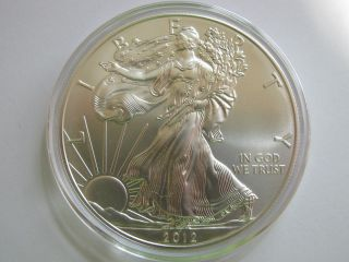 2012 1 Oz Uncirculated American Silver Eagle.  999 Fine In Airtite photo