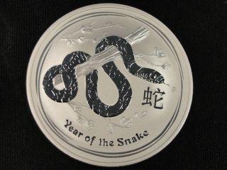 2013 Australia Year Of The Snake Silver Dollar.  999 Fine Silver Bullion photo