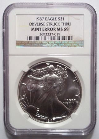 1987 Silver Eagle Dollar Error Obverse Struck Thru Ngc Ms69 Rare photo