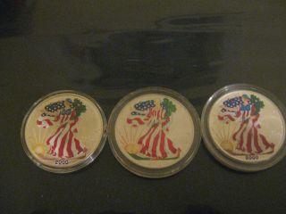 3 - 1 Oz,  2000 Milenium Colorized American Silver Eagles photo
