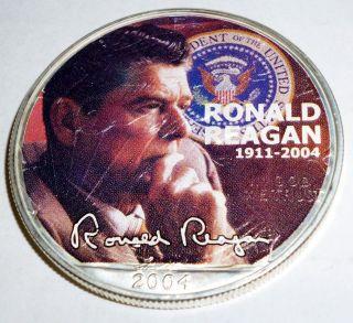 2004 1 Oz.  Ronald Reagan Silver Walking Liberty Dollar Full Color Coin 1911 - 2004 photo