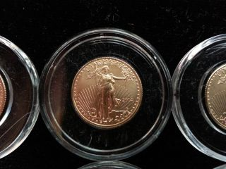 Eight 1/10 Ounce Gold Eagles 2014 Bu In Airtites 8/10 Ounces.  999 Gold photo