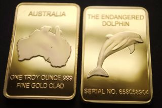 Gold Bullion Bar.  999 Gold Clad Australian Dolphin 1 Oz Unusual Gold Plated photo