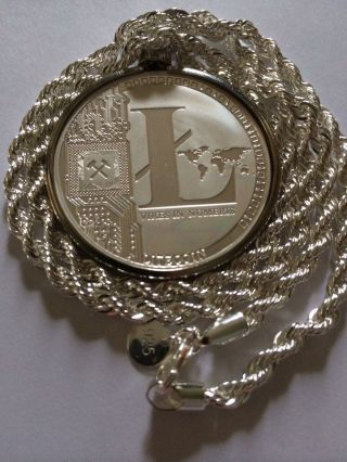 Litecoin Coin Pendant On Silver Rope Chain Necklace. photo