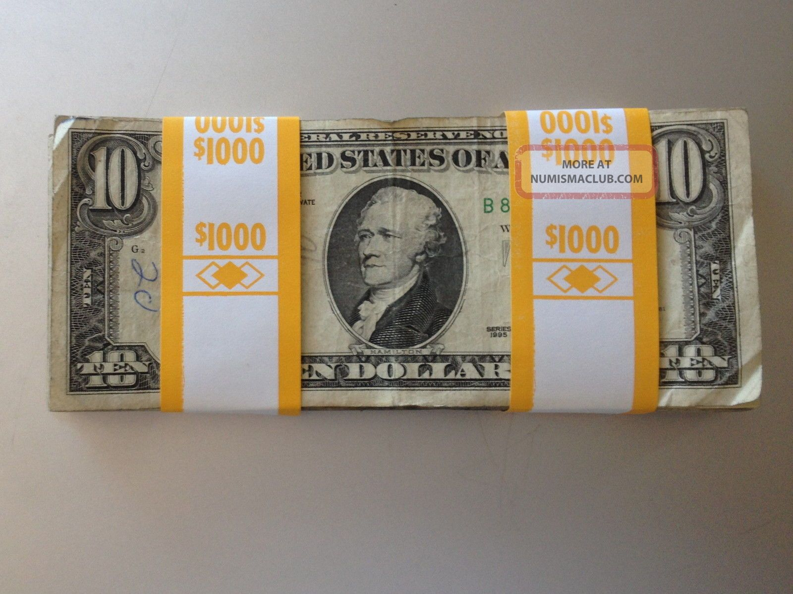 1000 strap of 10 dollar bills die pack tracking device real