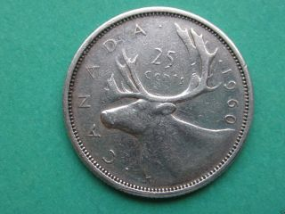 1960 Canadian Quarter (25c Silver Coin).  1267 photo