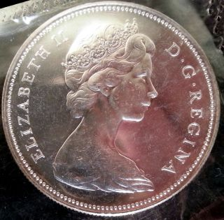 Brilliant Uncirculated 1966 Large Beads Canada Silver Dollar In Cello photo
