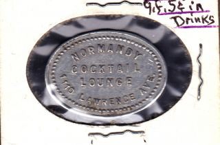 Uncat.  Normany Cocktail Lounge Chicago,  Illinois 5 Cents Drink Token photo