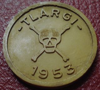 1953 Ochre Tlargi Skull & Cross Bones Token (the Los Angeles Rubber Group Inc. ) photo