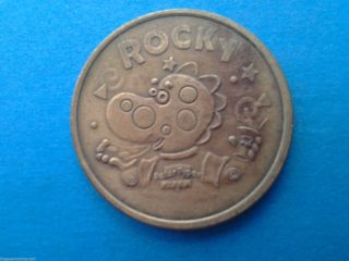Vintage 1995 Video Arcade Type Rocky Peter Piper Pizza Half Dollar Sized Token photo
