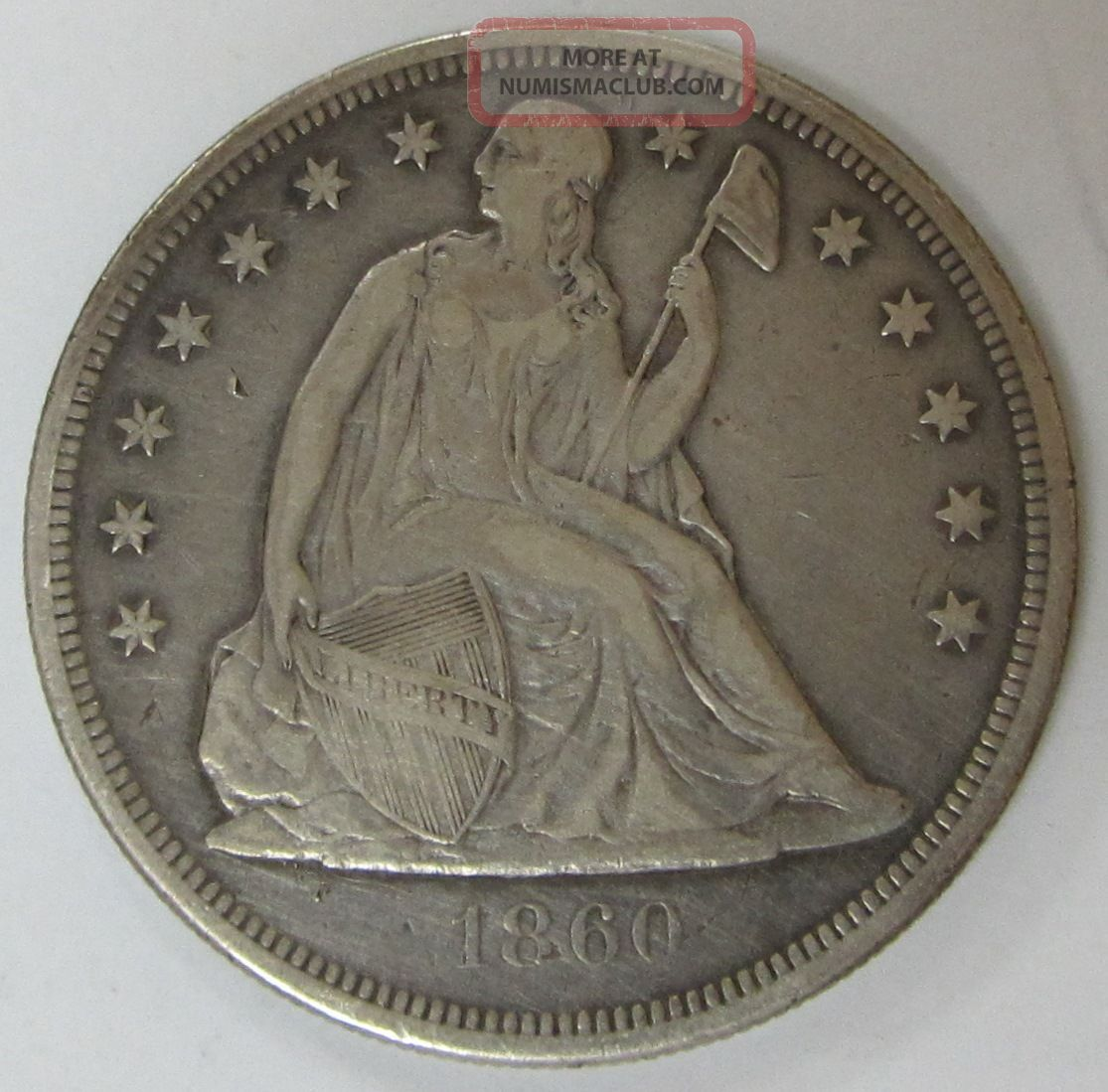 1860 - O Us Seated Liberty Silver Dollar With Dollars photo
