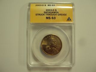 2003 - D Sacagawea Dollar,  Anacs Ms 63,  Struck Thru Grease photo