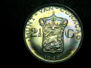 Curacao,  2 1/2 Gulden,  1944.  Unc With Light Rainbow Toning,  Silver Dollar Size photo