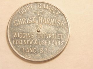 Vintage Spinner Token Ad For Wiggins Chevrolet; Lancaster,  Pa Phone Number photo
