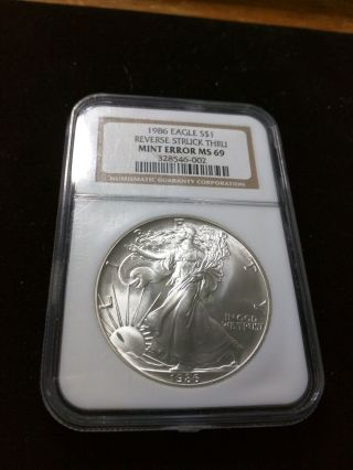 1986 $1 American Silver Eagle Ngc Ms 69 Reverse Struck Thru Error photo