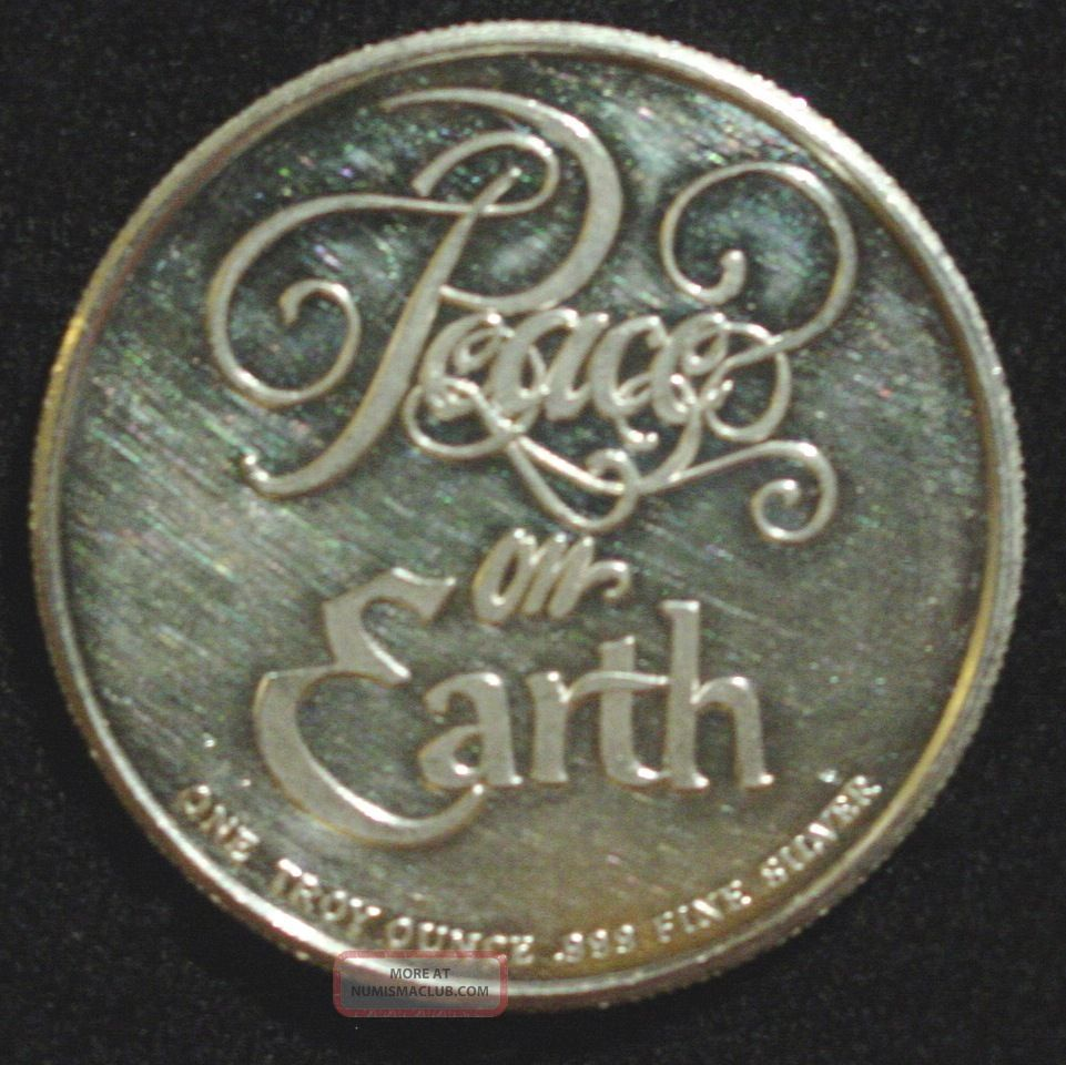 One Troy Ounce Fine Silver Coin 1994 Peace On Earth Merry