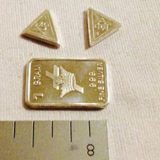 1.  665 Grams.  999 Pure Silver 1 Gram Bar And 1 Grain Triangle photo