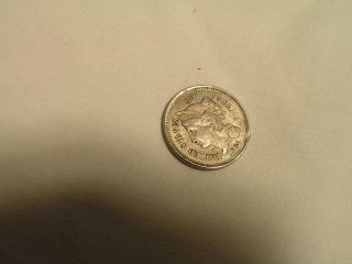 An 1865 Nickle 3 - Cent Treme Coin photo