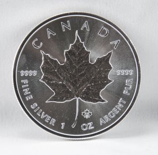 2014 Canada 1 Troy Oz.  9999 Fine Silver Maple Leaf $5 Coin photo