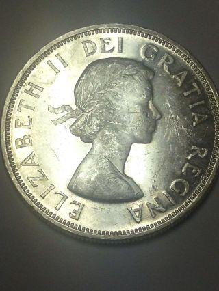 Uncirculated 1964 Canadian One Dollar Silver 80 Silver. photo