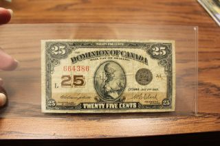 1923 Dominion Of Canada Black Seal A - 1 664386 Campbell /clark L Ser.  Circulated photo