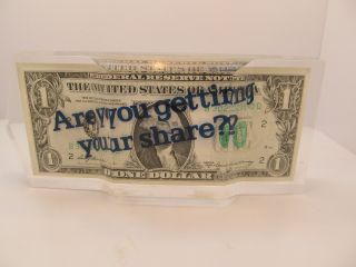 A Lucite Embedded Dollar Bill,  Series 1969a,  With The American Can Logo photo