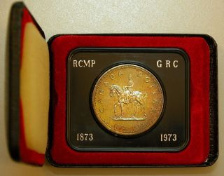 1973 Canada Rcmp Silver Dollar Uncirculated Coin With Collector Case Toned photo