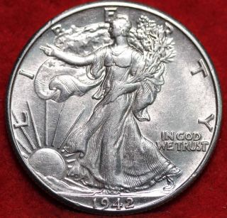 Uncirculated 1942 Philadelphia Silver Walking Liberty Half S/h photo