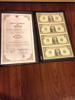 World Reserve Monetary Exchange 2009 (4) $1 Bills Uncirculated & Uncut photo