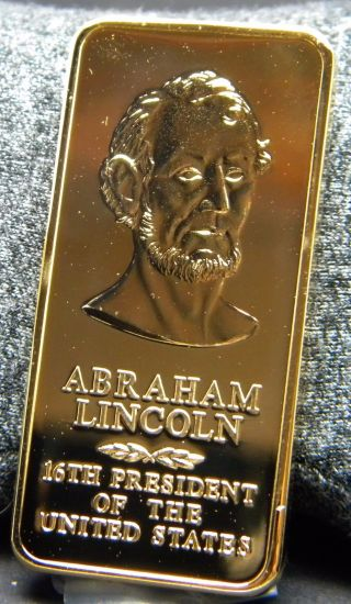 Abraham Lincoln 1 Oz.  Clad Ingot; Proof Finished In 24 Kt.  Gold photo