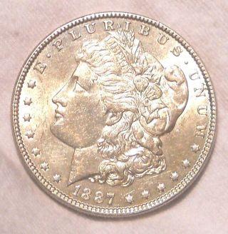 1887 Morgan Silver Dollar Au/bu photo