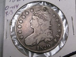 1829 Silver Us Bust Half Dollar.  Grades @ F/vf But Plugged.  Card Says O - 114,  R - 3 photo