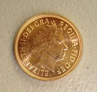 2013 British Gold Sovereign Uncirculated,  7.  98 Grams.  9167 Fine photo