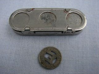 Vintage Metal Token Dispenser Holder & One Evanston Bus Token photo