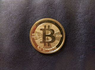2013 Casascius Coin Brass Half Btc Loaded photo