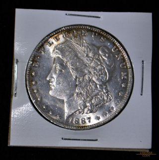 1887 $1 Morgan Silver Dollar,  Crisp And Lustrous,  Bu photo