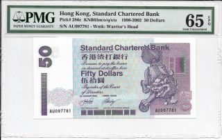 Standard Chartered Bank - $50,  2002.  Pmg 65epq.  Flower Logo. photo